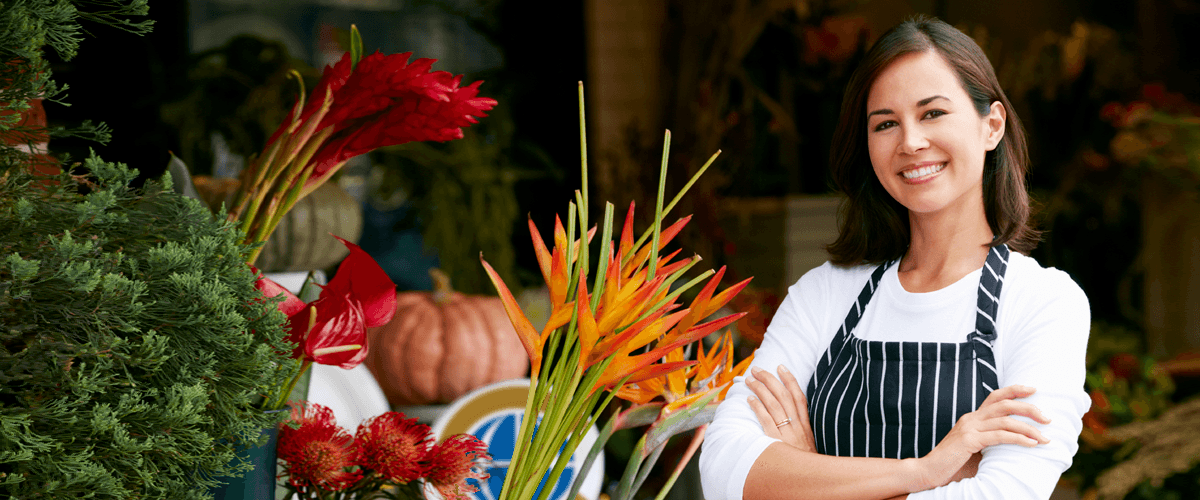Woman smiling business owner flower shop